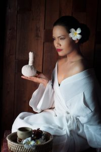 Massage-Tampon-aux-herbes-aromatiques-200x300 massage on woman body in the spa